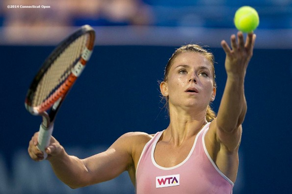 """""""Camila Giorgi serves during a match against Garbine Muguruza on day seven of the 2014 Connecticut Open at the Yale University Tennis Center in New Haven, Connecticut Thursday, August 21, 2014."""""""