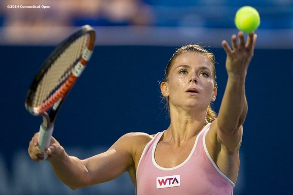 """Camila Giorgi serves during a match against Garbine Muguruza on day seven of the 2014 Connecticut Open at the Yale University Tennis Center in New Haven, Connecticut Thursday, August 21, 2014."""