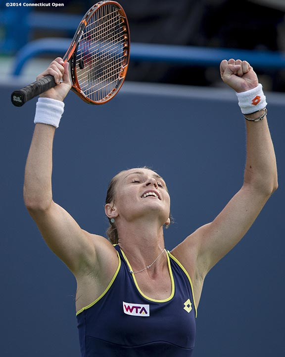 """Magdalena Rybarikova reacts after defeating Alison Riske on day seven of the 2014 Connecticut Open at the Yale University Tennis Center in New Haven, Connecticut Thursday, August 21, 2014."""