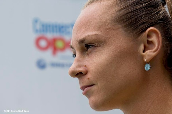 """Magdalena Rybarikova looks on before the semi-final match against Camila Giorgi on day eight of the 2014 Connecticut Open at the Yale University Tennis Center in New Haven, Connecticut Friday, August 22, 2014."""