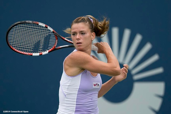 """""""Camila Giorgi hits a backhand during the semi-final match against Magdalena Rybarikova on day eight of the 2014 Connecticut Open at the Yale University Tennis Center in New Haven, Connecticut Friday, August 22, 2014."""""""
