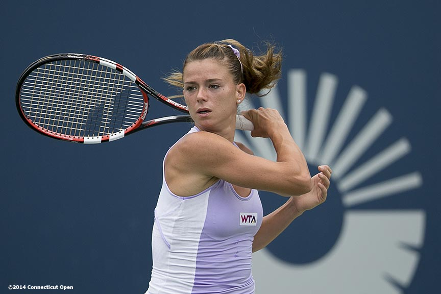 """Camila Giorgi hits a backhand during the semi-final match against Magdalena Rybarikova on day eight of the 2014 Connecticut Open at the Yale University Tennis Center in New Haven, Connecticut Friday, August 22, 2014."""