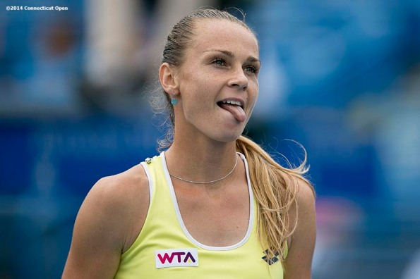 """""""Magdalena Rybarikova reacts during the semi-final match against Camila Giorgi on day eight of the 2014 Connecticut Open at the Yale University Tennis Center in New Haven, Connecticut Friday, August 22, 2014."""""""