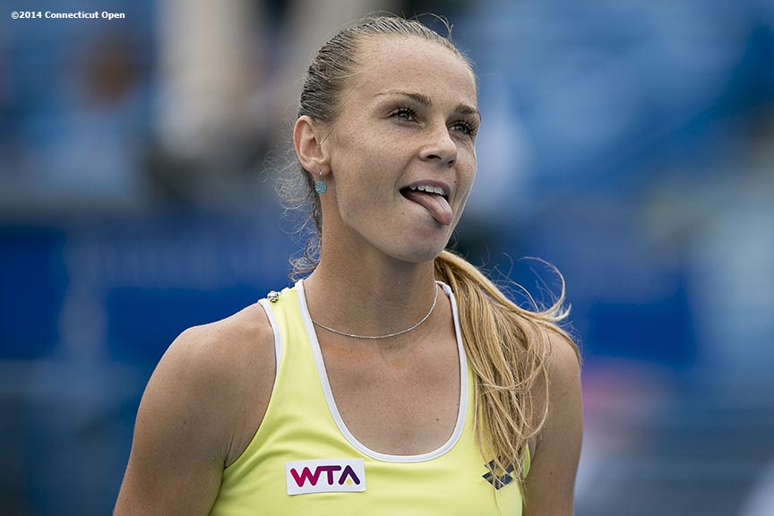 """Magdalena Rybarikova reacts during the semi-final match against Camila Giorgi on day eight of the 2014 Connecticut Open at the Yale University Tennis Center in New Haven, Connecticut Friday, August 22, 2014."""