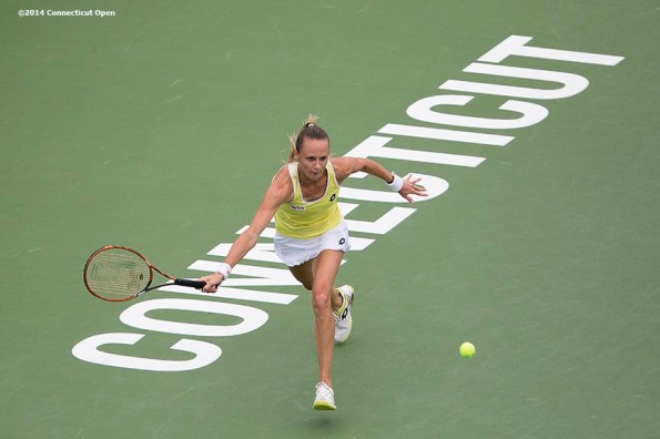 """Magdalena Rybarikova hits a forehand during the semi-final match against Camila Giorgi on day eight of the 2014 Connecticut Open at the Yale University Tennis Center in New Haven, Connecticut Friday, August 22, 2014."""