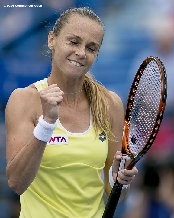 """Magdalena Rybarikova reacts after defeating Camila Giorgi in the semi-finals on day eight of the 2014 Connecticut Open at the Yale University Tennis Center in New Haven, Connecticut Friday, August 22, 2014."""