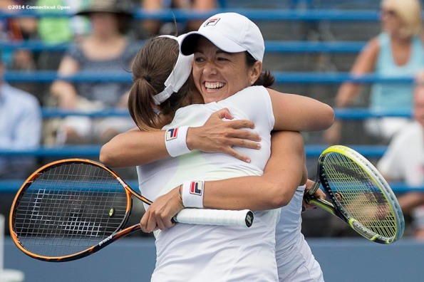 """Andreja Klepac and Silvia Soler-Espinosa celebrate after winning the doubles finals against  Marina Erakovic and Arantxa Parra Santonja on day nine of the 2014 Connecticut Open at the Yale University Tennis Center in New Haven, Connecticut Saturday, August 23, 2014."""