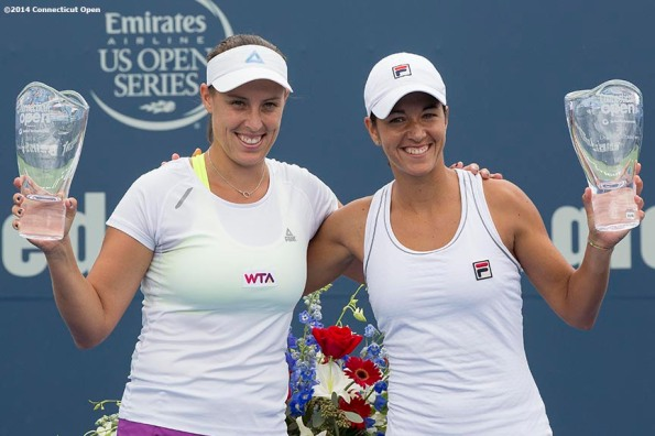 """""""Andreja Klepac and Silvia Soler-Espinosa pose for a photograph with the trophies during a ceremony after the doubles final against Marina Erakovic and Arantxa Parra Santonja on day nine of the 2014 Connecticut Open at the Yale University Tennis Center in New Haven, Connecticut Saturday, August 23, 2014."""""""