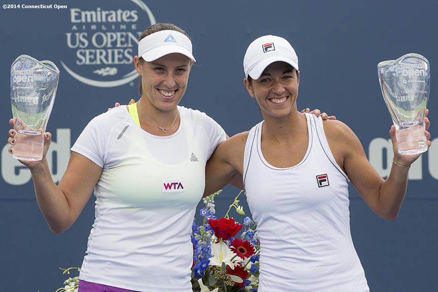 """Andreja Klepac and Silvia Soler-Espinosa pose for a photograph with the trophies during a ceremony after the doubles final against Marina Erakovic and Arantxa Parra Santonja on day nine of the 2014 Connecticut Open at the Yale University Tennis Center in New Haven, Connecticut Saturday, August 23, 2014."""