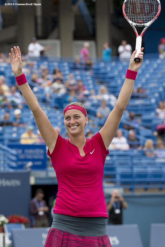 """""""Petra Kvitova reacts after match point to win the singles final against Magdalena Rybarikova on day nine of the 2014 Connecticut Open at the Yale University Tennis Center in New Haven, Connecticut Saturday, August 23, 2014."""""""