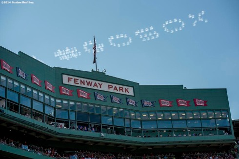 """Airplanes form a cloud formation reading #GoSox during a game between the Boston Red Sox and the Seattle Mariners at Fenway Park in Boston, Massachusetts Sunday, August 24, 2014."""