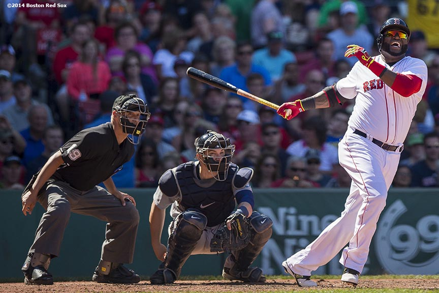 """Boston Red Sox designated hitter David Ortiz fouls a ball off of his leg during the fourth inning of a game against the Seattle Mariners at Fenway Park in Boston, Massachusetts Sunday, August 24, 2014."""