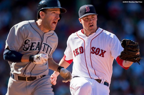 """Boston Red Sox pitcher Heath Hembree tags out outfielder Chris Denorfia during the sixth inning of a game against the Seattle Mariners at Fenway Park in Boston, Massachusetts Sunday, August 24, 2014."""