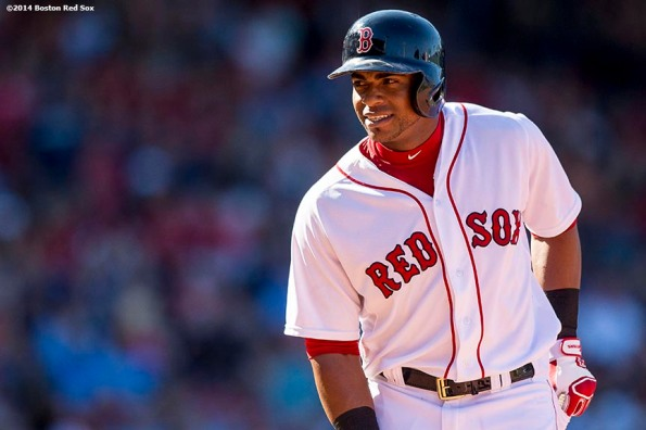"""Boston Red Sox left fielder Yoenis Cespedes smiles after hitting a single during the sixth inning of a game against the Seattle Mariners at Fenway Park in Boston, Massachusetts Sunday, August 24, 2014."""