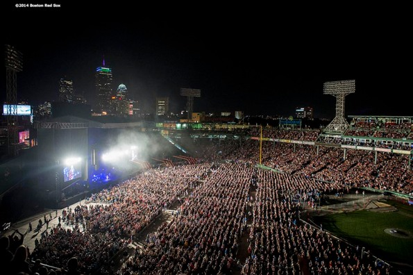 """""""Fans watch as Tom Petty and the Heartbreakers perform during a concert with Steve Winwood at Fenway Park in Boston, Massachusetts Saturday, August 30, 2014."""""""