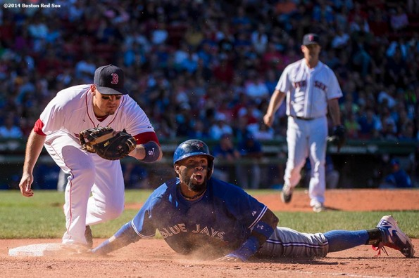 """Boston Red Sox first baseman Allen Craig tags out shortstop Jose Reyes as he is picked off by pitcher Steven Wright during the seventh inning of a game against the Toronto Blue Jays Sunday, September 7, 2014 at Fenway Park in Boston, Massachusetts."""