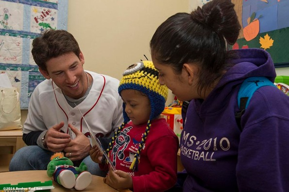 """Boston Red Sox pitcher Craig Breslow visits a patient at Boston Children's Hospital in Boston, Massachusetts Monday, September 22, 2014."""