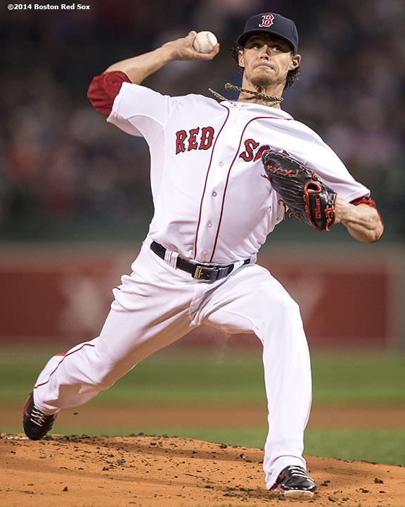 """Boston Red Sox pitcher Clay Buchholz delivers during the first inning of a game against the Tampa Bay Rays Tuesday, September 23, 2014 at Fenway Park in Boston, Massachusetts."""