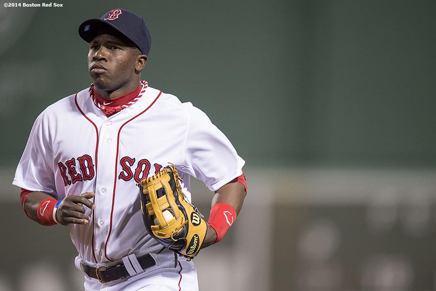 """Boston Red Sox center fielder Rusney Castillo runs toward the dugout during the fourth inning of a game against the Tampa Bay Rays Tuesday, September 23, 2014 at Fenway Park in Boston, Massachusetts. It was his first career game at Fenway Park. """