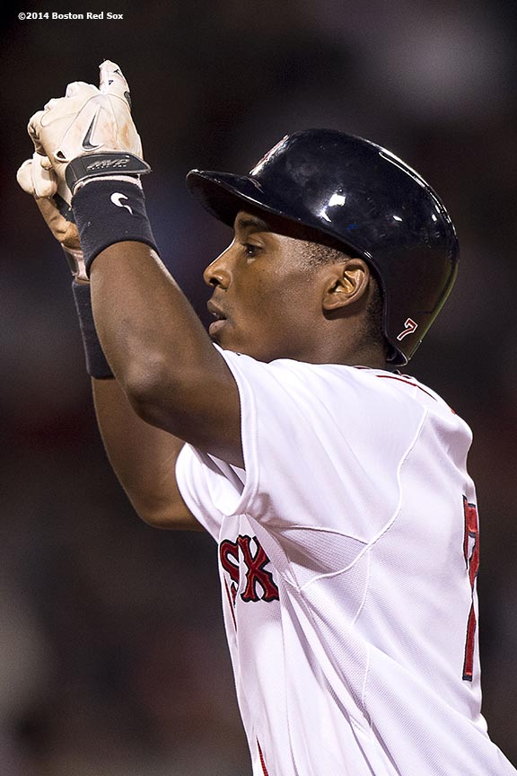 """Boston Red Sox shortstop Jemile Weeks gestures after hitting a single during the sixth inning of a game against the Tampa Bay Rays Tuesday, September 23, 2014 at Fenway Park in Boston, Massachusetts."""
