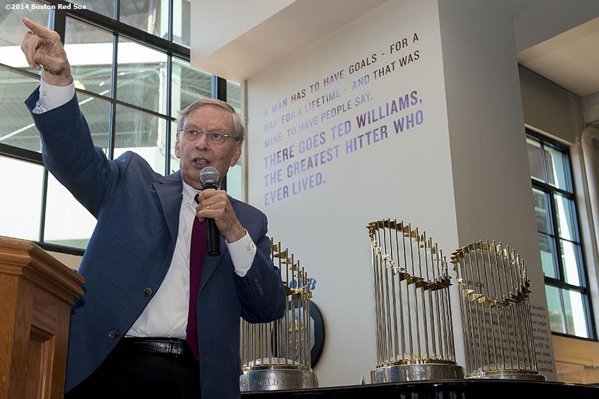 """Major League Baseball Commissioner Allan ""Bud"" Selig speaks to members of the Boston Red Sox front office alongside the 2004, 2007, and 2013 World Series trophies during a visit at Fenway Park in Boston, Massachusetts Saturday, September 27, 2014. """