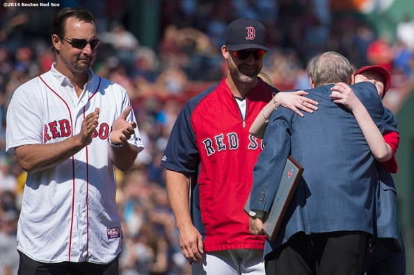 """Major League Baseball Commissioner Allan ""Bud"" Selig greets Jimmy Fund patient Erin Harkins during a pre-game ceremony at Fenway Park in Boston, Massachusetts Saturday, September 27, 2014. """