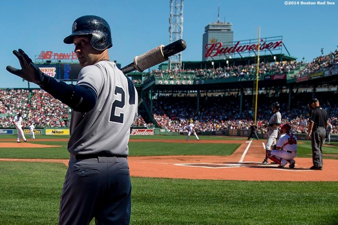 """New York Yankees shortstop Derek Jeter waves from the on deck circle during the first inning of a game against the Boston Red Sox at Fenway Park in Boston, Massachusetts Saturday, September 27, 2014. It was his second to last career Major League game."""