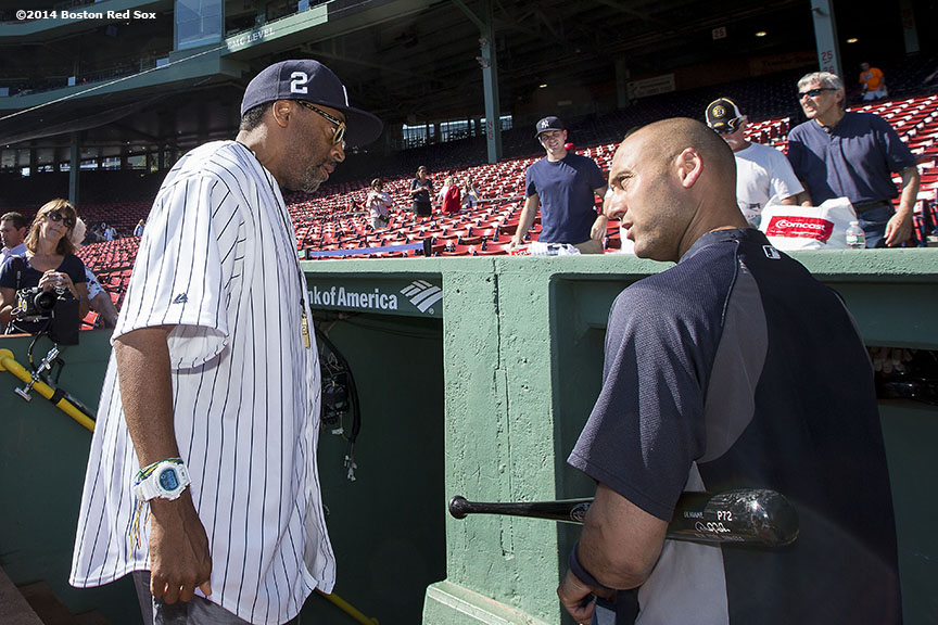 """New York Yankees shortstop Derek Jeter talks with film director Spike Lee before a game against the Boston Red Sox at Fenway Park in Boston, Massachusetts Sunday, September 28, 2014. It was Jeter's last career Major League game. """