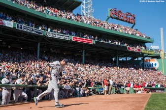 """New York Yankees shortstop Derek Jeter runs onto the field during a pre-game ceremony honoring his last career Major League game before a game against the Boston Red Sox at Fenway Park in Boston, Massachusetts Sunday, September 28, 2014. """