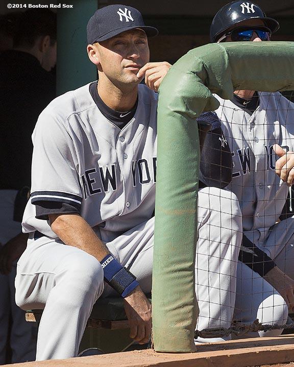"""New York Yankees shortstop Derek Jeter sits in the dugout before being introduced during a pre-game ceremony before a game against the Boston Red Sox at Fenway Park in Boston, Massachusetts Sunday, September 28, 2014. It was Jeter's last career Major League game."""