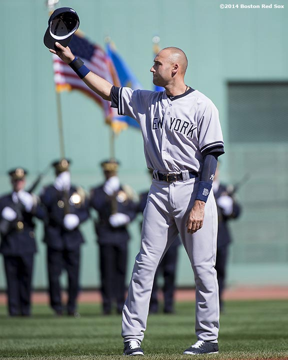 """New York Yankees shortstop Derek Jeter tips his cap as he is introduced during a pre-game ceremony honoring his last career Major League game before a game against the Boston Red Sox at Fenway Park in Boston, Massachusetts Sunday, September 28, 2014. """