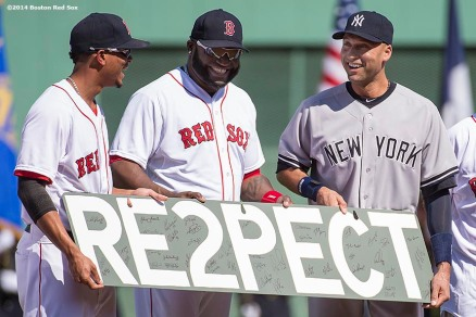"""Boston Red Sox designated hitter David Ortiz and shortstop Xander Bogaerts present New York Yankees shortstop Derek Jeter with a gift during a pre-game ceremony honoring his last career Major League game before a game at Fenway Park in Boston, Massachusetts Sunday, September 28, 2014. """