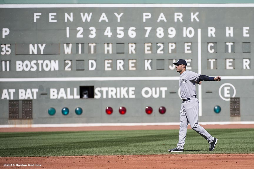 """New York Yankees shortstop Derek Jeter warms up as the Green Monster scoreboard reads 'With Re2pect to Derek Jeter' before a game against the Boston Red Sox at Fenway Park in Boston, Massachusetts Sunday, September 28, 2014. It was Jeter's last career Major League game. """