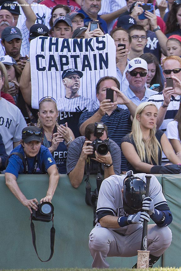 """New York Yankees shortstop Derek Jeter waits in the on deck circle during the first inning of a game against the Boston Red Sox at Fenway Park in Boston, Massachusetts Sunday, September 28, 2014. It was Jeter's last career Major League game. """