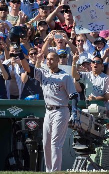 """New York Yankees shortstop Derek Jeter salutes the crowd after his final career at bat during the third inning of a game at Fenway Park in Boston, Massachusetts Sunday, September 28, 2014. It was Jeter's last career Major League game."""