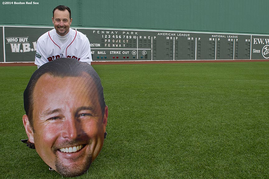 """Former Boston Red Sox pitcher Tim Wakefield poses for a photograph with a cut out of himself during the Knuckleballs to the Walls batting practice session sponsored by Heineken at Fenway Park in Boston, Massachusetts Friday, October 24, 2014."""
