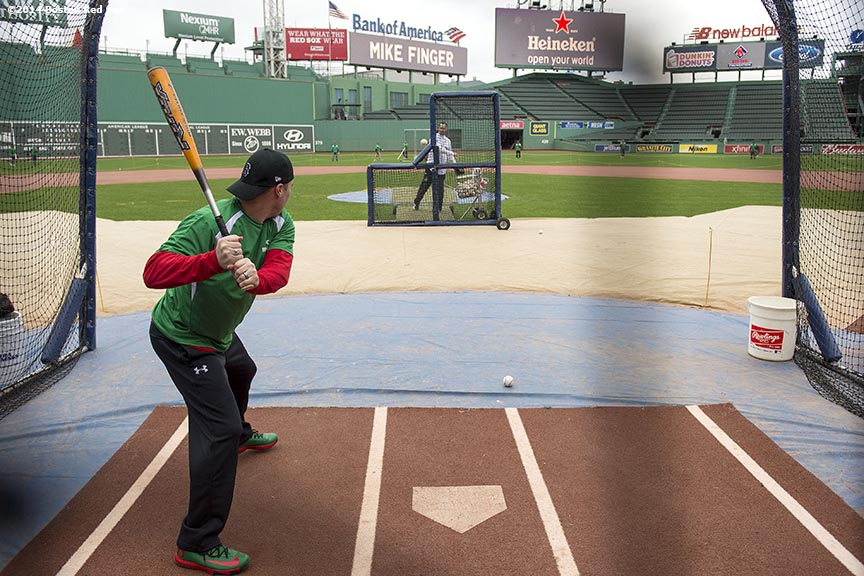 """A guest takes batting practice during the Knuckleballs to the Walls batting practice session sponsored by Heineken at Fenway Park in Boston, Massachusetts Friday, October 24, 2014."""