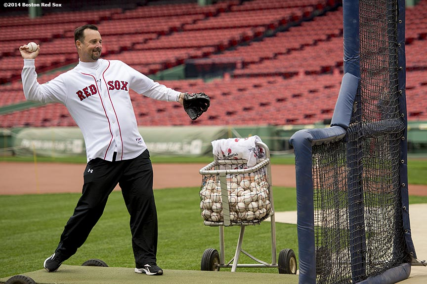 """Former Boston Red Sox pitcher Tim Wakefield throws batting practice to guests during the Knuckleballs to the Walls batting practice session sponsored by Heineken at Fenway Park in Boston, Massachusetts Friday, October 24, 2014."""