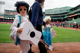 """Trick or treaters walk the warning track during Halloween at Fenway at Fenway Park in Boston, Massachusetts Thursday, October 30, 2014."""