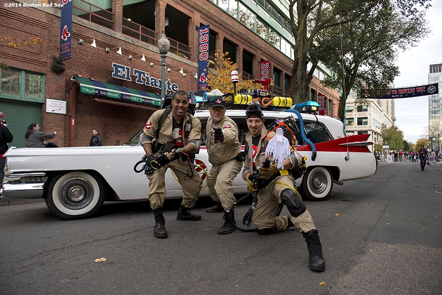 """Ghostbusters pose for a photograph on Yawkey Way during Halloween at Fenway at Fenway Park in Boston, Massachusetts Thursday, October 30, 2014."""
