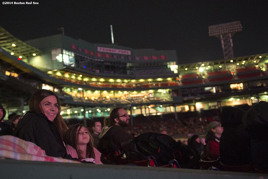 """Guests watch a movie screening of 'Ghostbusters' during Halloween at Fenway at Fenway Park in Boston, Massachusetts Thursday, October 30, 2014."""