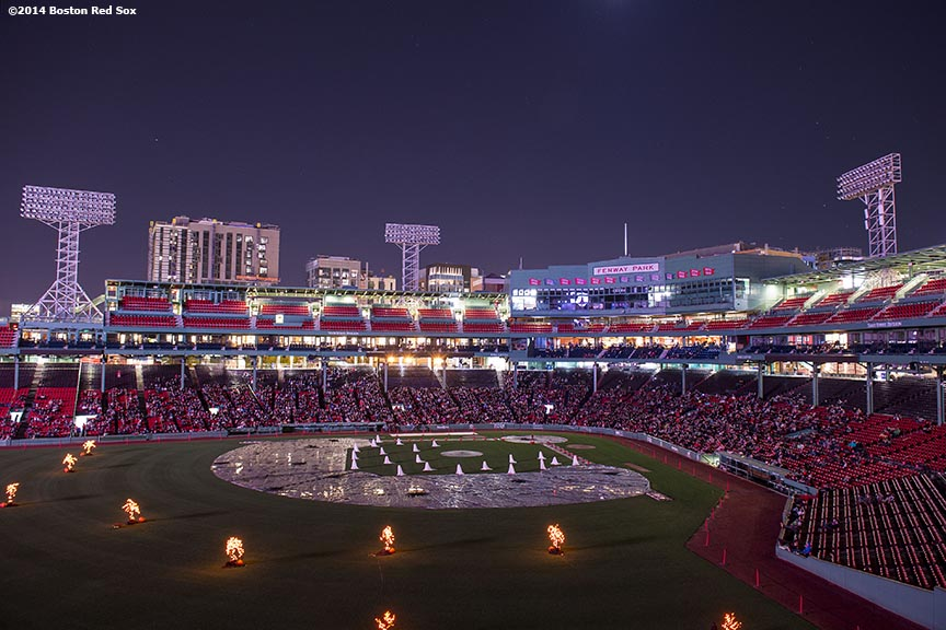 """""""Guests fill the lower seating bowl for a movie screening of 'Ghostbusters' during Halloween at Fenway at Fenway Park in Boston, Massachusetts Thursday, October 30, 2014."""""""