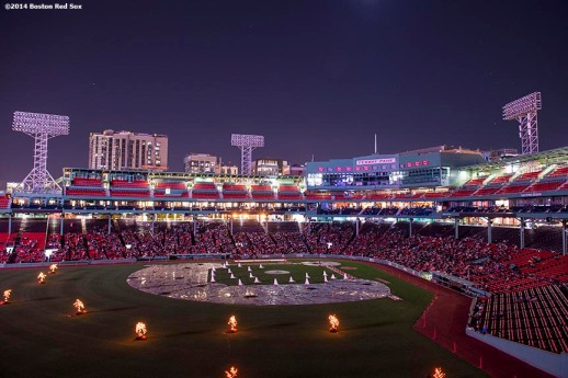 """Guests fill the lower seating bowl for a movie screening of 'Ghostbusters' during Halloween at Fenway at Fenway Park in Boston, Massachusetts Thursday, October 30, 2014."""