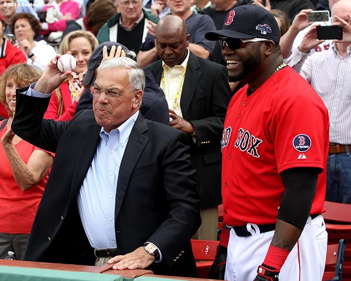 """Boston Mayor Tom Menino throws out the ceremonial first pitch alongside designated hitter David Ortiz during a pre-game ceremony before the first game of the American League Division Series between the Boston Red Sox and the Tampa Bay Rays. """