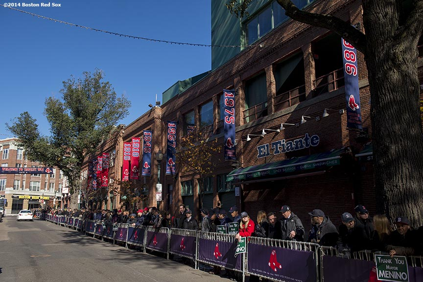 """Members of the Boston Red Sox front office line Yawkey Way to pay respects during the funeral procession for former Boston Mayor Thomas Menino at Fenway Park in Boston, Massachusetts Monday, November 3, 2014."""