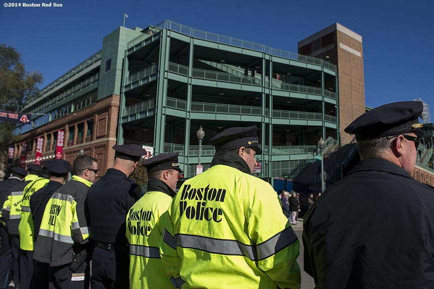 """Members of the Boston Police Department line Yawkey Way as the funeral procession for former Boston Mayor Thomas Menino passes by Fenway Park in Boston, Massachusetts Monday, November 3, 2014."""