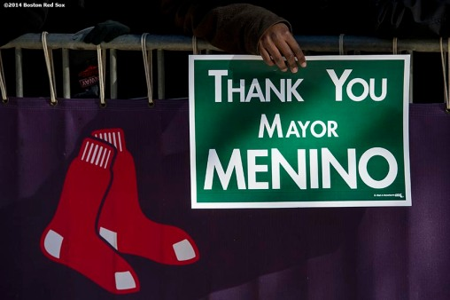 """""""A member of the Boston Red Sox front office holds a sign as employees line Yawkey Way to pay respects during the funeral procession for former Boston Mayor Thomas Menino at Fenway Park in Boston, Massachusetts Monday, November 3, 2014."""""""