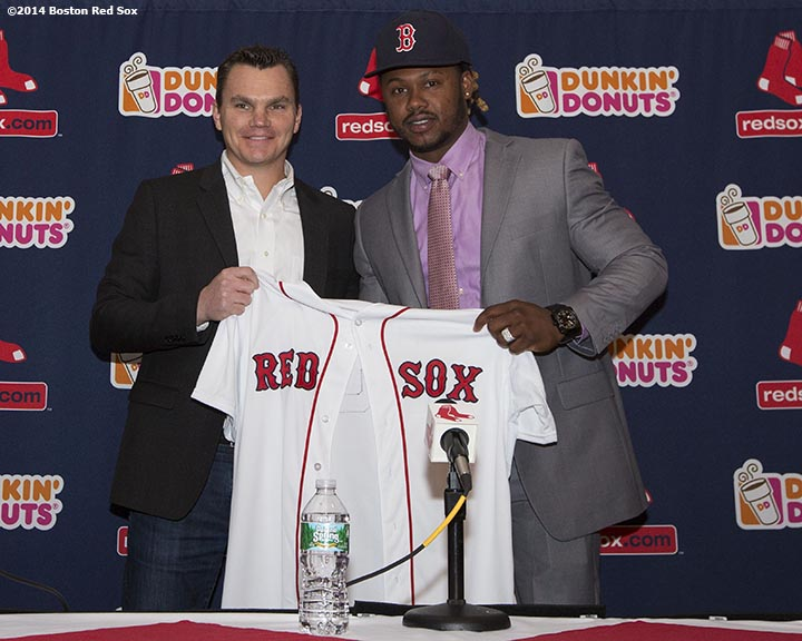 """Boston Red Sox General Manager Ben Cherington presents a jersey to newly acquired left fielder Hanley Ramirez during a press conference announcing a four-year contract at Fenway Park in Boston, Massachusetts Tuesday, November 25, 2014."""