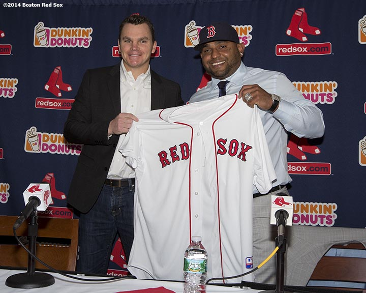 """Boston Red Sox General Manager Ben Cherington presents Pablo Sandoval with a jersey during a press conference announcing a five-year contract at Fenway Park in Boston, Massachusetts Tuesday, November 25, 2014."""