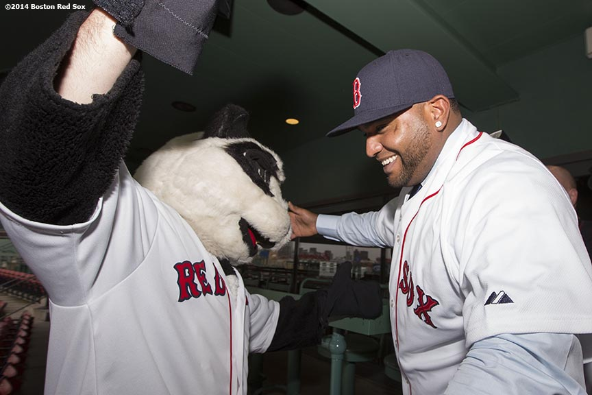 """Newly acquired Boston Red Sox third baseman Pablo Sandoval poses for a photograph with a Panda mascot during a press conference announcing a five-year contract at Fenway Park in Boston, Massachusetts Tuesday, November 25, 2014."""